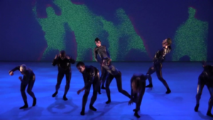 The background effect show countless particles. Green show where the dancers are, red where they have been.